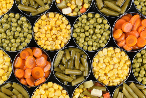 Group of open canned vegetables
