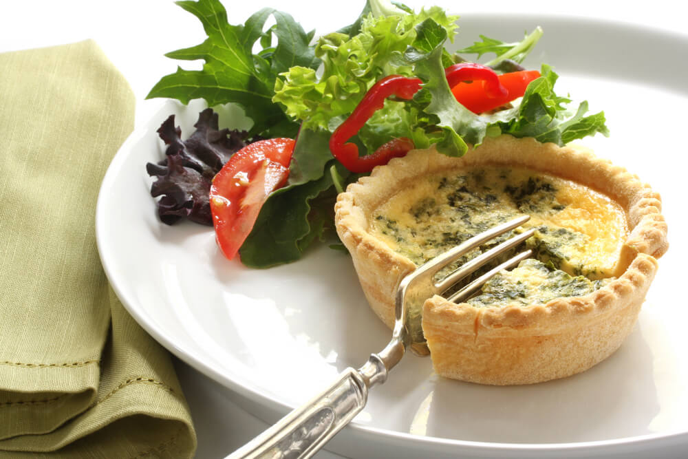 A small spinache quiche with a side salad. A light, delicious lunch.